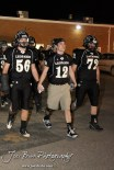 LaCrosse Leopards Trey Renz (#56), Clayton Basgall (#12), and Matthew Wagner (#72) lead their team out to the field before the Oakley at LaCrosse KSHSAA Class 2-1A Sectional Football Playoff game with LaCrosse winning 20-8 at LaCrosse High School in LaCrosse, Kansas on November 9, 2012. (Photo: Joey Bahr, www.joeybahr.com)