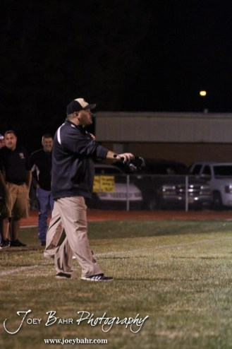 LaCrosse Leopard Head Coach Jon Webster signals in a play during the Oakley at LaCrosse KSHSAA Class 2-1A Sectional Football Playoff game with LaCrosse winning 20-8 at LaCrosse High School in LaCrosse, Kansas on November 9, 2012. (Photo: Joey Bahr, www.joeybahr.com)