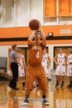 Kiowa County Maverick Caleb Davis (#4) shoots a free throw attempt during the Larned Indians versus Kiowa County Mavericks First Round Game with Kiowa County winning 63 to 45 at the 6th Annual Keady Basketball Classic held at Larned Middle School in Larned, Kansas on December 3, 2012. (Photo: Joey Bahr, www.joeybahr.com)