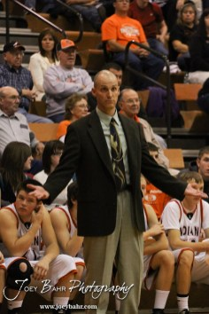 Larned Indian Head Coach Don Zimmerman signals his disagreement with a call to the refs during the Larned Indians versus Kiowa County Mavericks First Round Game with Kiowa County winning 63 to 45 at the 6th Annual Keady Basketball Classic held at Larned Middle School in Larned, Kansas on December 3, 2012. (Photo: Joey Bahr, www.joeybahr.com)