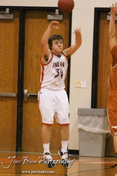 Larned Indian Camryn Bryant (#34) throws a pass to a teammate during the Larned Indians versus Kiowa County Mavericks First Round Game with Kiowa County winning 63 to 45 at the 6th Annual Keady Basketball Classic held at Larned Middle School in Larned, Kansas on December 3, 2012. (Photo: Joey Bahr, www.joeybahr.com)