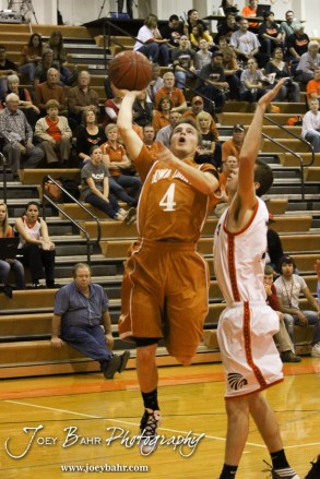 Kiowa County Maverick Caleb Davis (#4) goes up for a layup during the Larned Indians versus Kiowa County Mavericks First Round Game with Kiowa County winning 63 to 45 at the 6th Annual Keady Basketball Classic held at Larned Middle School in Larned, Kansas on December 3, 2012. (Photo: Joey Bahr, www.joeybahr.com)