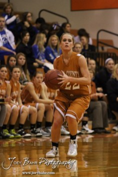 Kiowa County Lady Maverick Riann Heft (#22) looks to pass the ball during the Larned Lady Indians versus Kiowa County Lady Mavericks First Round Game with Larned winning 50 to 39 at the 6th Annual Keady Basketball Classic held at Larned Middle School in Larned, Kansas on December 3, 2012. (Photo: Joey Bahr, www.joeybahr.com)
