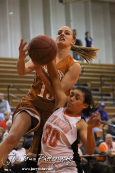 Larned Lady Indian Shay Shepherd (#30) knocks the ball out of the hands of Kiowa County Lady Maverick Heather Melton (#13) during the Larned Lady Indians versus Kiowa County Lady Mavericks First Round Game with Larned winning 50 to 39 at the 6th Annual Keady Basketball Classic held at Larned Middle School in Larned, Kansas on December 3, 2012. (Photo: Joey Bahr, www.joeybahr.com)