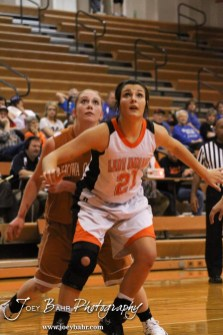 Larned Lady Indian Maci Perez (#21) blocks out Kiowa County Lady Maverick Katelynn Gamble (#0) during the Larned Lady Indians versus Kiowa County Lady Mavericks First Round Game with Larned winning 50 to 39 at the 6th Annual Keady Basketball Classic held at Larned Middle School in Larned, Kansas on December 3, 2012. (Photo: Joey Bahr, www.joeybahr.com)