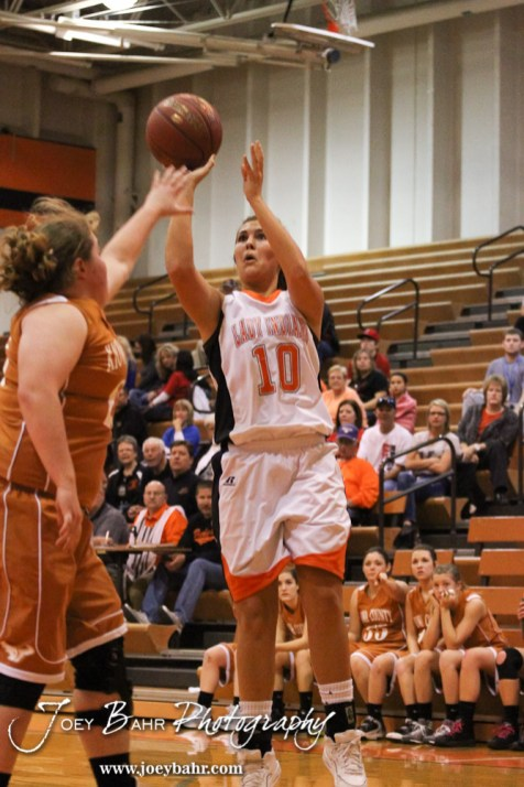 Kiowa County Lady Maverick Halie Headrick (#23) tries to block a shot from Larned Lady Indian Bailey Schartz (#10) during the Larned Lady Indians versus Kiowa County Lady Mavericks First Round Game with Larned winning 50 to 39 at the 6th Annual Keady Basketball Classic held at Larned Middle School in Larned, Kansas on December 3, 2012. (Photo: Joey Bahr, www.joeybahr.com)