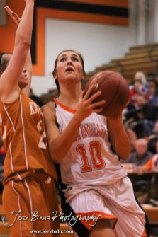 Kiowa County Lady Maverick Riann Heft (#22) tries to defend as Larned Lady Indian Bailey Schartz (#10) goes up for a layup during the Larned Lady Indians versus Kiowa County Lady Mavericks First Round Game with Larned winning 50 to 39 at the 6th Annual Keady Basketball Classic held at Larned Middle School in Larned, Kansas on December 3, 2012. (Photo: Joey Bahr, www.joeybahr.com)