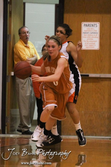 Kiowa County Lady Maverick Katelynn Gamble (#0) drives down the court with the ball during the Larned Lady Indians versus Kiowa County Lady Mavericks First Round Game with Larned winning 50 to 39 at the 6th Annual Keady Basketball Classic held at Larned Middle School in Larned, Kansas on December 3, 2012. (Photo: Joey Bahr, www.joeybahr.com)