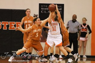 Kiowa County Lady Maverick Chelsea Oberle (#5) reaches in while Larned Lady Indian Reagan Quick (#11) looks to make a pass during the Larned Lady Indians versus Kiowa County Lady Mavericks First Round Game with Larned winning 50 to 39 at the 6th Annual Keady Basketball Classic held at Larned Middle School in Larned, Kansas on December 3, 2012. (Photo: Joey Bahr, www.joeybahr.com)