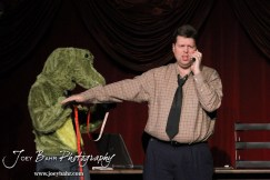 """Gator Creature/Phil played by Lynn Benefield measures Lester played by Jeff Gibson during the Great Bend Community Theater's final rehearsal of """"Duck Hunter Shoots Angel"""" by Mitch Albom at Crest Theater in Great Bend, Kansas on April 17, 2013. (Photo: Joey Bahr, www.joeybahr.com)"""