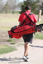Liberal Redskin Blake Brenneman walks to the next tee box during the Great Bend High School Boys Golf Invitational Tournament at The Club at Stoneridge in Great Bend, Kansas on April 29, 2013. (Photo: Joey Bahr, www.joeybahr.com)
