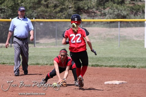 Liberal Lady Redskin Cynthia Cisneros (#5) tries to field the ball as Great Bend Lady Panther McKenna Mauler runs to Second during the Liberal Lady Redskins at Great Bend Lady Panthers Softball Double Header with Great Bend winning both games 18-0 (3 innings) 13-0 at Barton Community College Softball Field in Great Bend, Kansas on April 27, 2013. (Photo: Joey Bahr, www.joeybahr.com)
