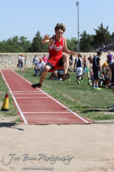 A Greeley County competitor reaches for more altitude in the long jump during the 2013 KSHSAA Class 1A Regional Track and Field competition at Lewis Field on the campus of Fort Hays State University in Hays, Kansas on May 17, 2013. (Photo: Joey Bahr, www.joeybahr.com)