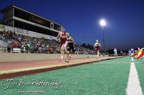 Competitors run down the straight in the Boys 3200 Meter Run during the 2013 KSHSAA Class 1A Regional Track and Field competition at Lewis Field on the campus of Fort Hays State University in Hays, Kansas on May 17, 2013. (Photo: Joey Bahr, www.joeybahr.com)