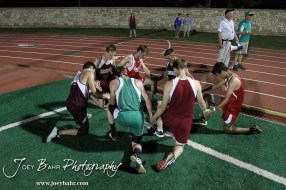 Runners from the Boys 3200 Meter Run gather to pray after the race during the 2013 KSHSAA Class 1A Regional Track and Field competition at Lewis Field on the campus of Fort Hays State University in Hays, Kansas on May 17, 2013. (Photo: Joey Bahr, www.joeybahr.com)