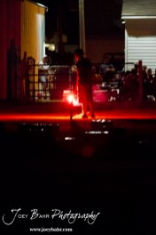A member of the Olmitz Fire Department lights a firework during the Olmitz City Fireworks Celebration at the Knights of Columbus Council #2100 Hall in Olmitz, Kansas on July 6, 2013. (Photo: Joey Bahr, www.joeybahr.com)