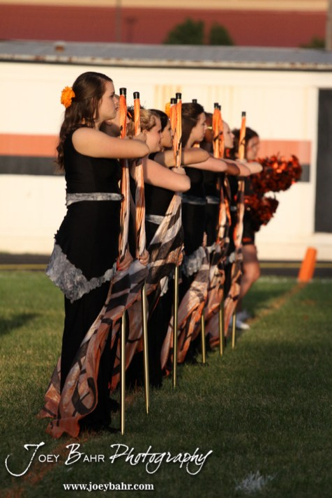 The Larned Indian Flag Line salutes the American Flag before the Ellinwood versus Larned High School football game with the Larned Indians winning 60 to 0 at Larned High School in Larned, Kansas on September 13, 2013. (Photo: Joey Bahr, www.joeybahr.com)