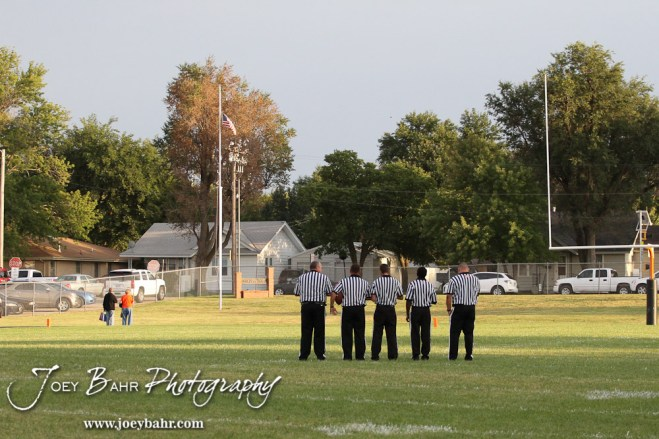 The Referees line up for the playing of the National Anthem before the Ellinwood versus Larned High School football game with the Larned Indians winning 60 to 0 at Larned High School in Larned, Kansas on September 13, 2013. (Photo: Joey Bahr, www.joeybahr.com)