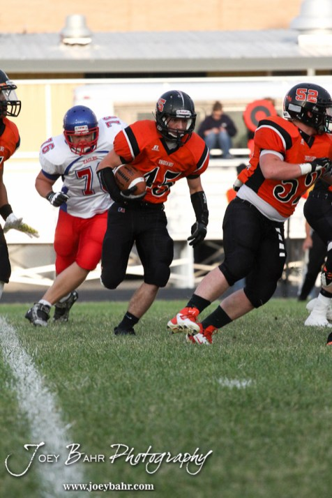 Larned Indian Landon Erway (#45) runs with the ball during the Ellinwood versus Larned High School football game with the Larned Indians winning 60 to 0 at Larned High School in Larned, Kansas on September 13, 2013. (Photo: Joey Bahr, www.joeybahr.com)