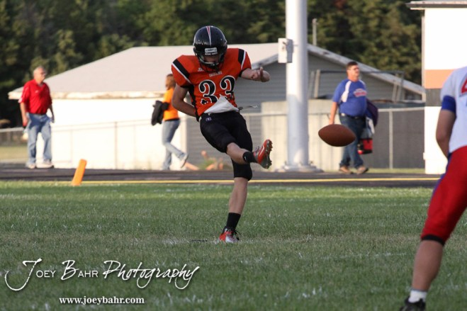 Larned Indian Michael Reece (#33) kicks the ball off during the Ellinwood versus Larned High School football game with the Larned Indians winning 60 to 0 at Larned High School in Larned, Kansas on September 13, 2013. (Photo: Joey Bahr, www.joeybahr.com)