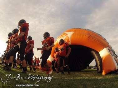 The Larned Indians walk out onto the field before the Ellinwood versus Larned High School football game with the Larned Indians winning 60 to 0 at Larned High School in Larned, Kansas on September 13, 2013. (Photo: Joey Bahr, www.joeybahr.com)