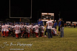 Ellinwood Eagle Head Coach Dusty Beam addresses his players following the Ellinwood versus Larned High School football game with the Larned Indians winning 60 to 0 at Larned High School in Larned, Kansas on September 13, 2013. (Photo: Joey Bahr, www.joeybahr.com)