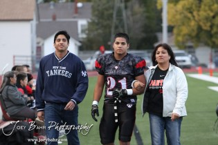 Great Bend Panther Jonathan Allende (#21 ) walks out with his parents for the before the start of the Salina Central versus Great Bend High School Football game with Salina Central winning 41 to 14 at Memorial Field in Great Bend, Kansas on October 25, 2013. (Photo: Joey Bahr, www.joeybahr.com)
