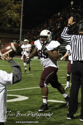 Salina Central Mustang Quintavian Hill (#99) celebrates an interception during the Salina Central versus Great Bend High School Football game with Salina Central winning 41 to 14 at Memorial Field in Great Bend, Kansas on October 25, 2013. (Photo: Joey Bahr, www.joeybahr.com)