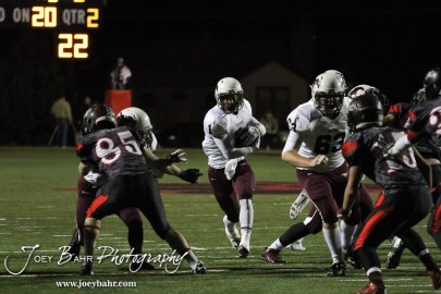 Salina Central Mustang Malik Veal (#1) looks for a hole during the Salina Central versus Great Bend High School Football game with Salina Central winning 41 to 14 at Memorial Field in Great Bend, Kansas on October 25, 2013. (Photo: Joey Bahr, www.joeybahr.com)