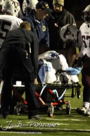 Teammates wish Salina Central Mustang Quintavian Hill (#99) well after injuring his leg during the Salina Central versus Great Bend High School Football game with Salina Central winning 41 to 14 at Memorial Field in Great Bend, Kansas on October 25, 2013. (Photo: Joey Bahr, www.joeybahr.com)