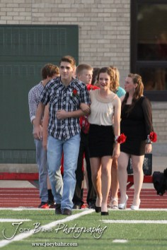 Candidates Hannah Wilborn and Cody Phelps walk out during the 2013 Hoisington High School Homecoming Festivities prior to the Larned at Hoisington Football game at Elton Brown Field in Hoisington, Kansas on October 11, 2013. (Photo: Joey Bahr, www.joeybahr.com)