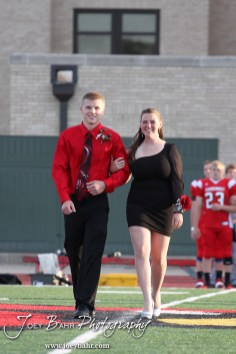 Candidates Deiah Curtis and Trent Schremmer walk out during the 2013 Hoisington High School Homecoming Festivities prior to the Larned at Hoisington Football game at Elton Brown Field in Hoisington, Kansas on October 11, 2013. (Photo: Joey Bahr, www.joeybahr.com)