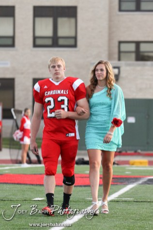 Candidates Jordin Greer and Avery Urban walk out during the 2013 Hoisington High School Homecoming Festivities prior to the Larned at Hoisington Football game at Elton Brown Field in Hoisington, Kansas on October 11, 2013. (Photo: Joey Bahr, www.joeybahr.com)
