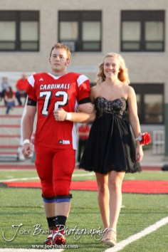 Candidates Abi Rziha and Kagan Blackwell walk out during the 2013 Hoisington High School Homecoming Festivities prior to the Larned at Hoisington Football game at Elton Brown Field in Hoisington, Kansas on October 11, 2013. (Photo: Joey Bahr, www.joeybahr.com)