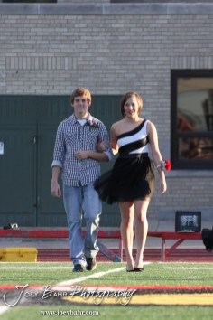 Candidates Ashley Lockwood and Lucas Flagor walk out during the 2013 Hoisington High School Homecoming Festivities prior to the Larned at Hoisington Football game at Elton Brown Field in Hoisington, Kansas on October 11, 2013. (Photo: Joey Bahr, www.joeybahr.com)
