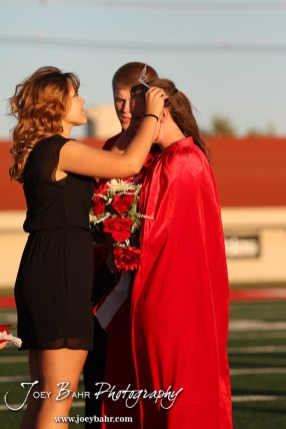 The Past Queen puts on the tiara to the newly crowned Queen, Deiah Curtis, during the 2013 Hoisington High School Homecoming Festivities prior to the Larned at Hoisington Football game at Elton Brown Field in Hoisington, Kansas on October 11, 2013. (Photo: Joey Bahr, www.joeybahr.com)