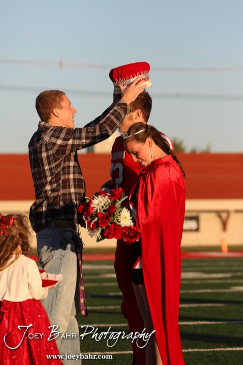 The Past King crowns the newly named King, Kagan Blackwell, during the 2013 Hoisington High School Homecoming Festivities prior to the Larned at Hoisington Football game at Elton Brown Field in Hoisington, Kansas on October 11, 2013. (Photo: Joey Bahr, www.joeybahr.com)
