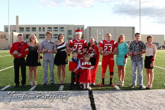 The Hoisington High School Homecoming King and Queen, Candidates, and Attendants stand for a group photo during the 2013 Hoisington High School Homecoming Festivities prior to the Larned at Hoisington Football game at Elton Brown Field in Hoisington, Kansas on October 11, 2013. (Photo: Joey Bahr, www.joeybahr.com)
