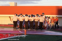 Larned Indian coaches lead their players onto the field before the Larned at Hoisington High School Football game with Hoisington winning 27 to 9 at Elton Brown Field in Hoisington, Kansas on October 11, 2013. (Photo: Joey Bahr, www.joeybahr.com)