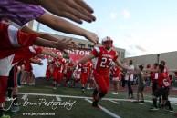 Hoisington Cardinal Avery Urban (#23) runs out onto the field prior to the Larned at Hoisington High School Football game with Hoisington winning 27 to 9 at Elton Brown Field in Hoisington, Kansas on October 11, 2013. (Photo: Joey Bahr, www.joeybahr.com)