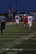 Larned Indian Tyler Stelter (#82) runs back a blocked field goal attempt for a touchdown during the Larned at Hoisington High School Football game with Hoisington winning 27 to 9 at Elton Brown Field in Hoisington, Kansas on October 11, 2013. (Photo: Joey Bahr, www.joeybahr.com)