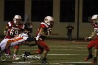 Larned Indian Tyler Stelter (#82) reaches to tackle Hoisington Cardinal Nolan McCurry (#22) during the Larned at Hoisington High School Football game with Hoisington winning 27 to 9 at Elton Brown Field in Hoisington, Kansas on October 11, 2013. (Photo: Joey Bahr, www.joeybahr.com)