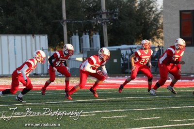 A group of Hoisington Cardinals participate in warmup exercises before the KSHSAA Class 4A District 15 Football game between Scott City and Hoisington with Scott City winning 14 to 0 at Elton Brown Field in Hoisington, Kansas on October 18, 2013. (Photo: Joey Bahr, www.joeybahr.com)
