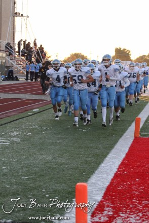 The Scott City Beavers head to the locker room prior to the KSHSAA Class 4A District 15 Football game between Scott City and Hoisington with Scott City winning 14 to 0 at Elton Brown Field in Hoisington, Kansas on October 18, 2013. (Photo: Joey Bahr, www.joeybahr.com)