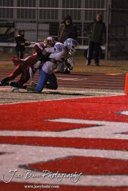 Hoisington Cardinal Taylor Richter (#7) covers Scott City Beaver Brayden Strine (#2) near the end zone during the KSHSAA Class 4A District 15 Football game between Scott City and Hoisington with Scott City winning 14 to 0 at Elton Brown Field in Hoisington, Kansas on October 18, 2013. (Photo: Joey Bahr, www.joeybahr.com)
