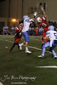 Hoisington Cardinal Brandon Ball (#9) breaks up a pass to Scott City Beaver Brayden Strine (#2) during the KSHSAA Class 4A District 15 Football game between Scott City and Hoisington with Scott City winning 14 to 0 at Elton Brown Field in Hoisington, Kansas on October 18, 2013. (Photo: Joey Bahr, www.joeybahr.com)