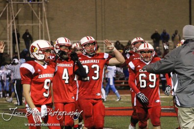 Hoisington Cardinals hold up four fingers to signal the start of the Fourth Quarter during the KSHSAA Class 4A District 15 Football game between Scott City and Hoisington with Scott City winning 14 to 0 at Elton Brown Field in Hoisington, Kansas on October 18, 2013. (Photo: Joey Bahr, www.joeybahr.com)