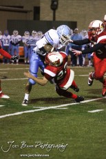 Hoisington Cardinal Avery Urban (#23) tackles Scott City Beaver Wyatt Kropp (#30) during the KSHSAA Class 4A District 15 Football game between Scott City and Hoisington with Scott City winning 14 to 0 at Elton Brown Field in Hoisington, Kansas on October 18, 2013. (Photo: Joey Bahr, www.joeybahr.com)