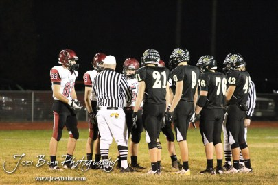 The captains for the LaCrosse Leopards and Plainville Cardinals meet at the center of the field for the coin toss during the Plainville versus LaCrosse KSHSAA Class 2-1A Regional Football Playoff game with LaCrosse winning 41 to 14 at Bill Schoenfelder Field in LaCrosse, Kansas on November 8, 2013. (Photo: Joey Bahr, www.joeybahr.com)