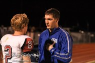 An athletic trainer gives Plainville Cardinal Trever Houser (#2) a concussion test during the Plainville versus LaCrosse KSHSAA Class 2-1A Regional Football Playoff game with LaCrosse winning 41 to 14 at Bill Schoenfelder Field in LaCrosse, Kansas on November 8, 2013. (Photo: Joey Bahr, www.joeybahr.com)
